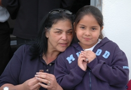 Flotilla member Beatrice Fregozo and small child at Whale of A day