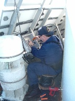 Kim Castrobran repairing aid at L A lighthouse